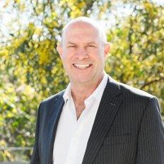 Andrew Huggins, Co-Principal/Licensee