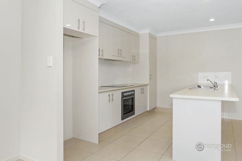 2/2 Starkey Street, Pacific Pines QLD 4211, Image 1