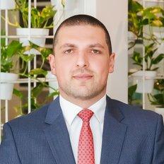 Ali Oksuz, Principal