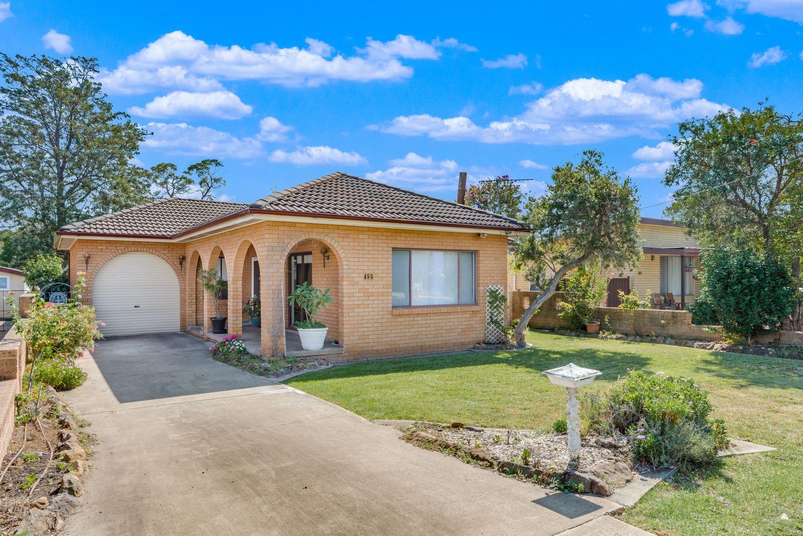 12 Parkland Avenue, Macquarie Fields NSW 2564, Image 1