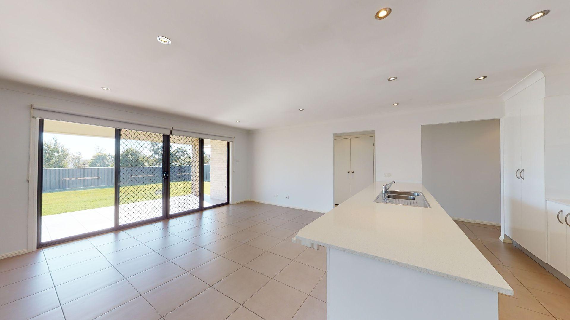 64 Dalmeny Drive, Macquarie Hills NSW 2285